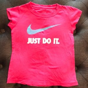 Nike pink tee with blue and white logo